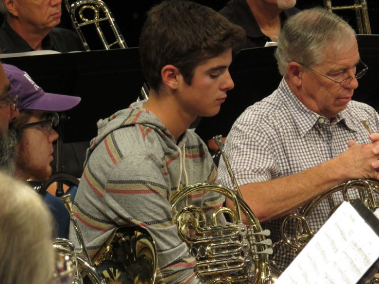 Taylor Smith awaits instruction during rehearsal. Photo by Warren Lieberman.
