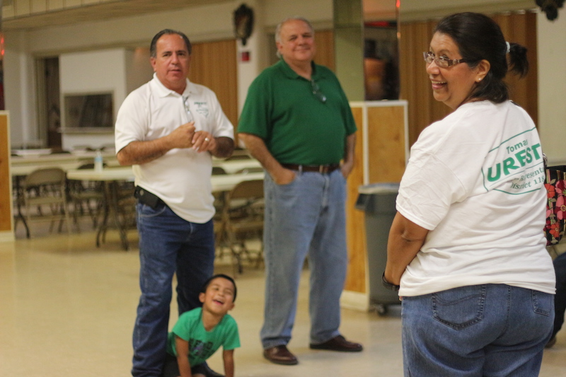 Bernice Uresti (right) turns around to smile at the crowd of Tomás Uresti's (left) supporter. Photo by Joan Vinson.