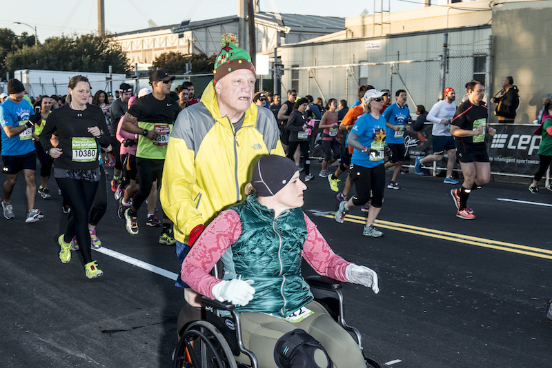 Several people participated in the race by running and pushing friends and loved ones in wheelchairs. Photo by Matthew Busch.