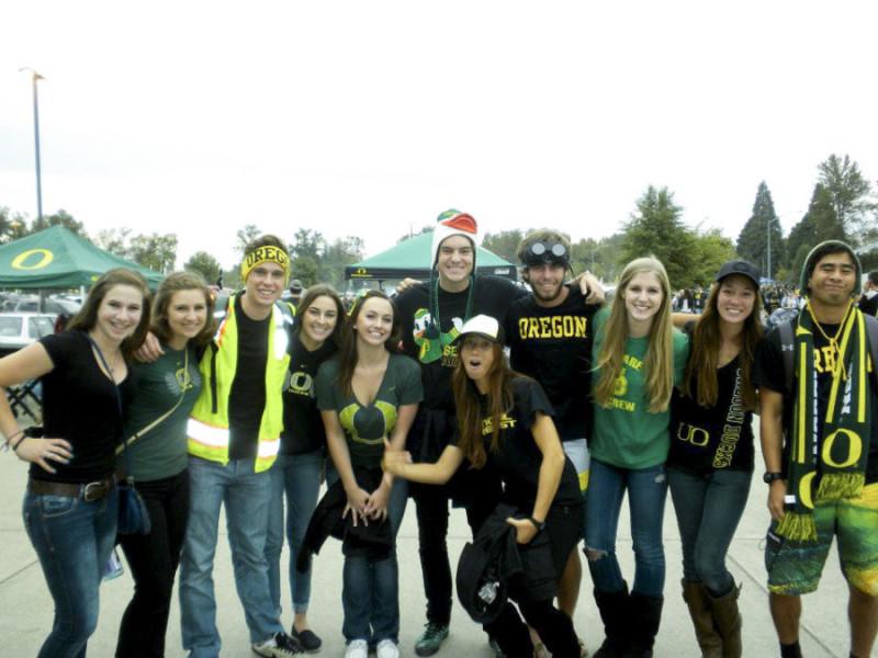 University of Oregon fans in full Frog gear. Photo by Kathryn Boyd-Batstone.