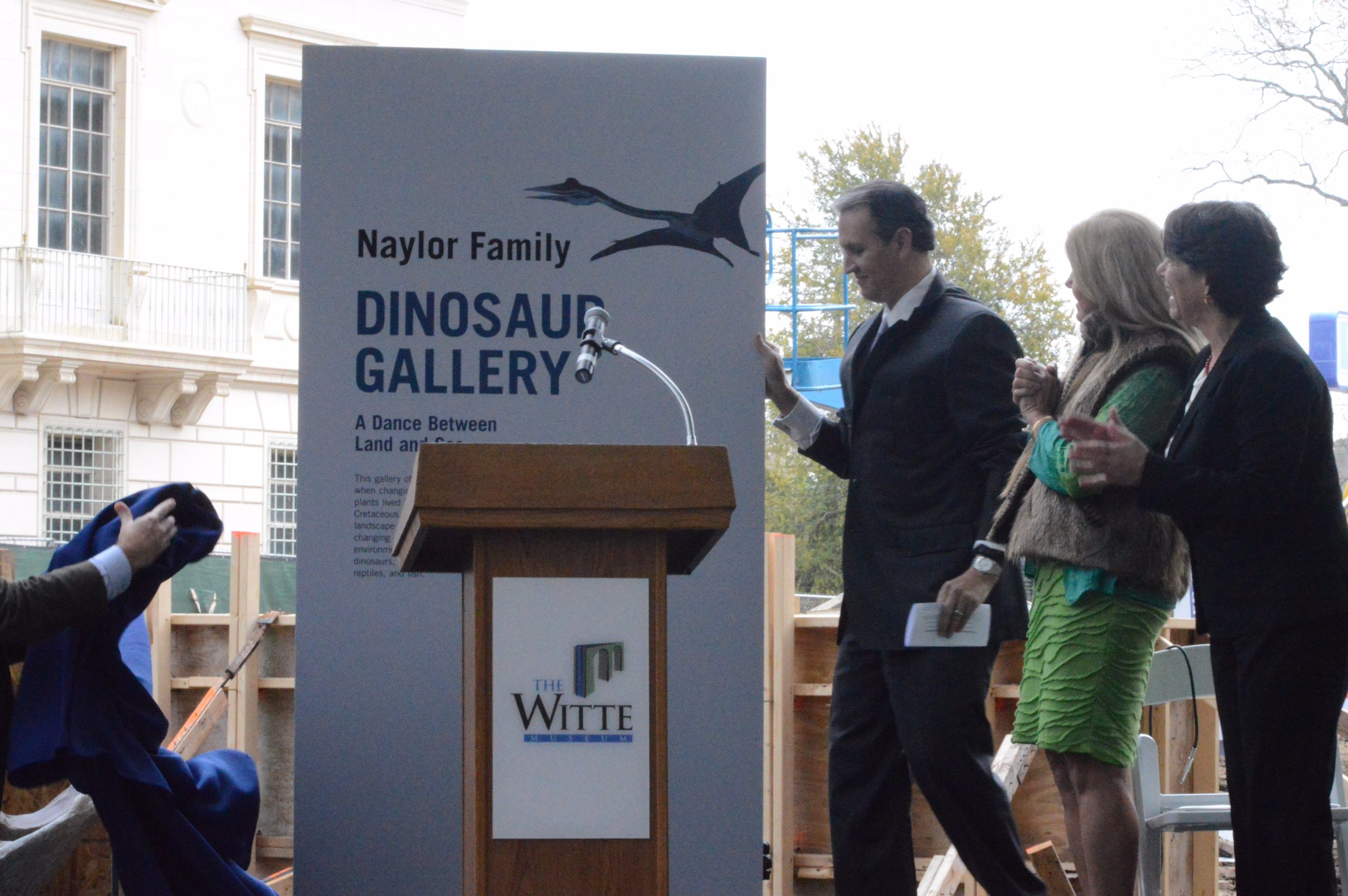 Officials reveal the signage for the Naylor Family Dinosaur Gallery at the Witte Museum. Photo by Lea Thompson.