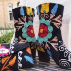 The embroidered fabric used for these boots and the purse is a traditional one in Uzbekistan. Photo by Abbey Francis.