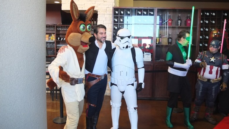 """(From left) The Spurs Coyote, Councilman Roberto """"Han Solo"""" Treviño (D1), and a stormtrooper pose for a photo before the screening. Photo by Abbey Francis."""