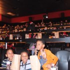 Children take their seats in the Alamo Drafthouse's auditorium. Photo by Abbey Francis.