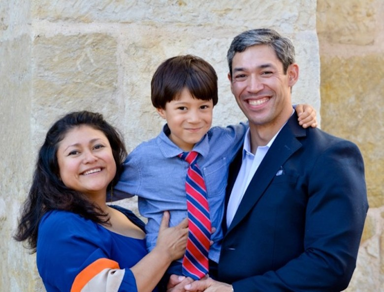 Erika Prosper (left), holds her son, Jonah, with her husband Councilman Ron Nirenberg (D8). Photo by Jonathan Alonzo.
