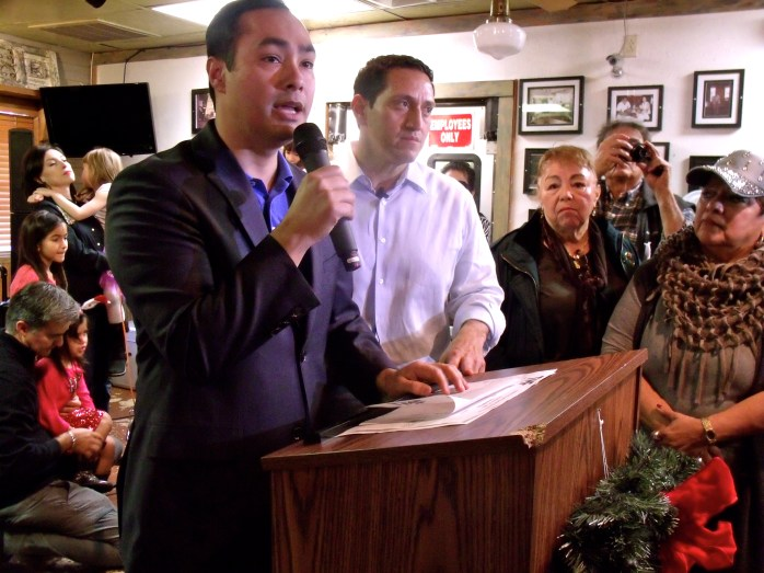 U.S. Rep. Joaquín Castro (D-20) addresses supporters of Trey Martinez Fischer (center) in a candidacy announcement party at Henry's Puffy Tacos on Sunday, Dec. 13, 2015. Photo by Edmond Ortiz
