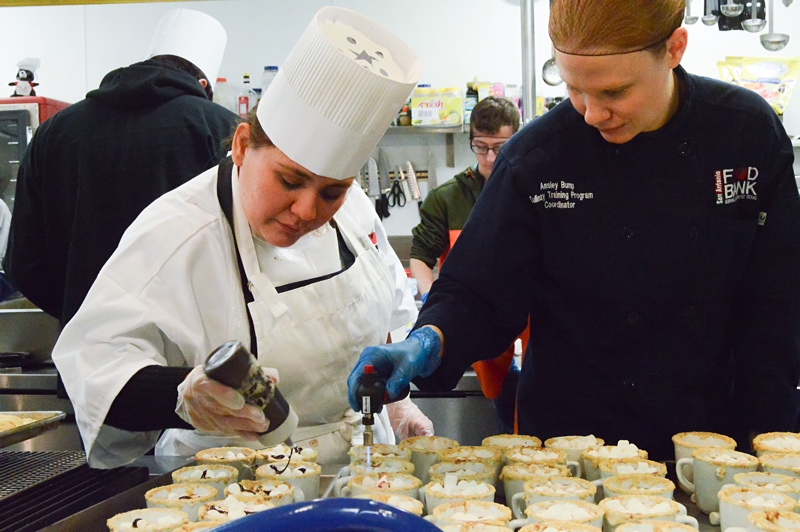 Top Image: Student Karla Saenz works with Ansley Bump, Culinary Training Program Coordinator, to prepare dessert for event attendees on Dec. 4, 2015. Photo by Lea Thompson.