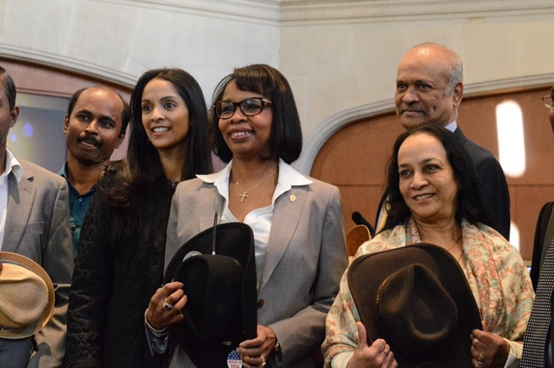 Mayor Ivy Taylor shows support for 'Hats off Chennai' with Anuja SA members. Photo by Lea Thompson.