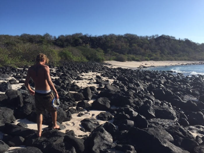Walking the rocky beach after an afternoon of snorkeling. Photo by Everett Redus.