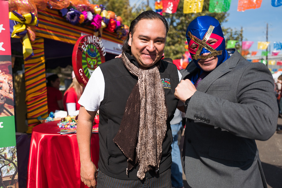 Chef Johnny Hernandez poses for a photo with a luchador in front of El Machito tamale stand. Photo by Scott Ball.