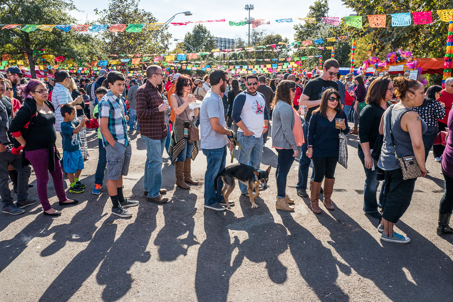 Guests wait in line for freshly made tamales. Photo by Scott Ball.