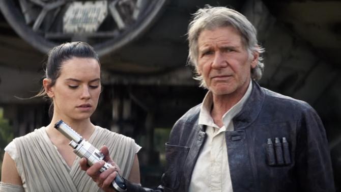 Han Solo (Harrison Ford) hands Rey () Luke Skywalker's lightsaber. Image courtesy of Disney.