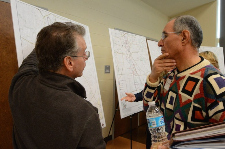 Resident Bill Bordelon and Razi Hosseini of the City's Transportation and Capital Improvements department discuss the possible infrastructure changes on road leading to the missions. Photo by Lea Thompson.