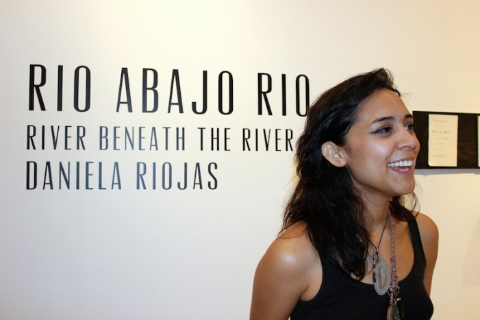 Daniela Riojas smiles while explaining her exhibition. Photo by Iris Gonzalez.
