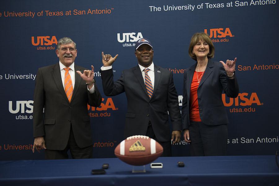 From left: UTSA President Ricardo Romo, UTSA Football head coach Frank Wilson, and UTSA Athletic Director Lynn Hickey smile for a photo during the press conference. Photo by Mark McClendon, courtesy of UTSA.