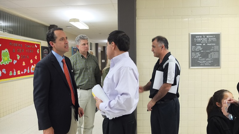 State Sen. José Menéndez speaks with attendees after the workshop. Photo by Abbey Francis.