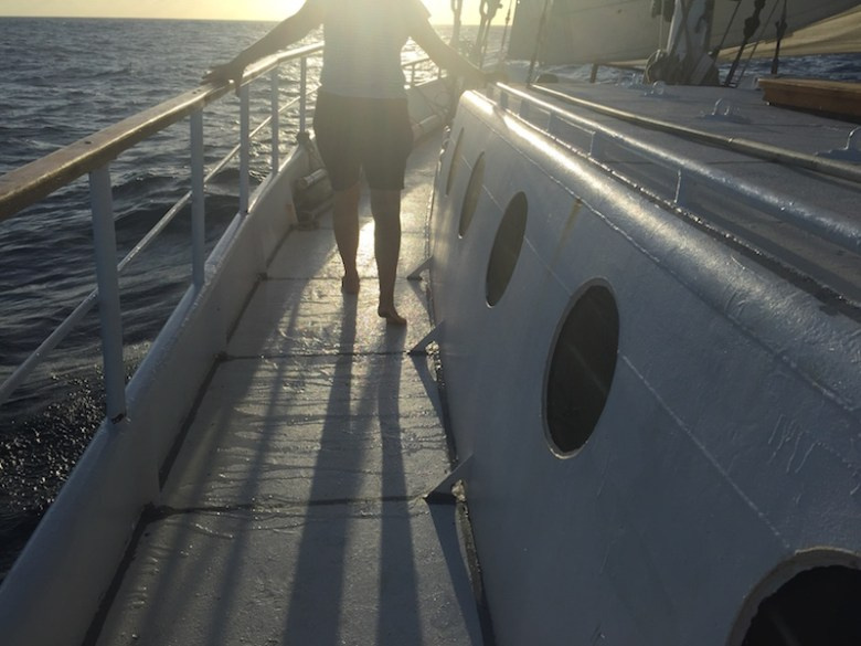 Rhonda heading up to the bow for the daily lowering of the jib. Photo by Everett Redus.