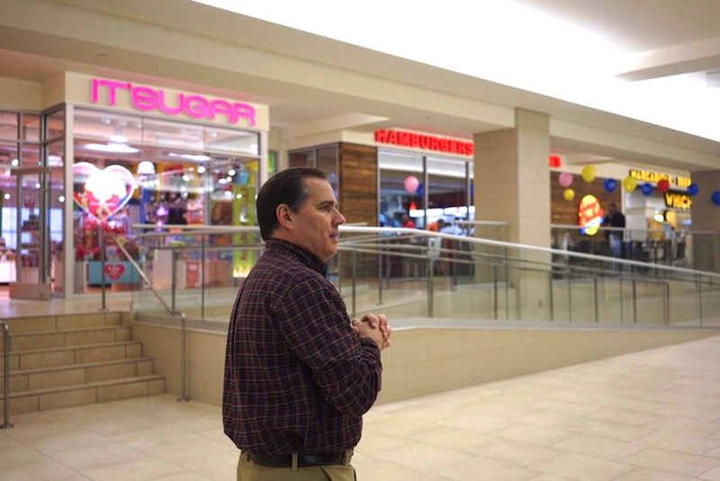 Shops at Rivercenter Mall General Manager Chris Oviatt walks through the newly-opened corridor through the former Joske's Building. Photo by Iris Dimmick.