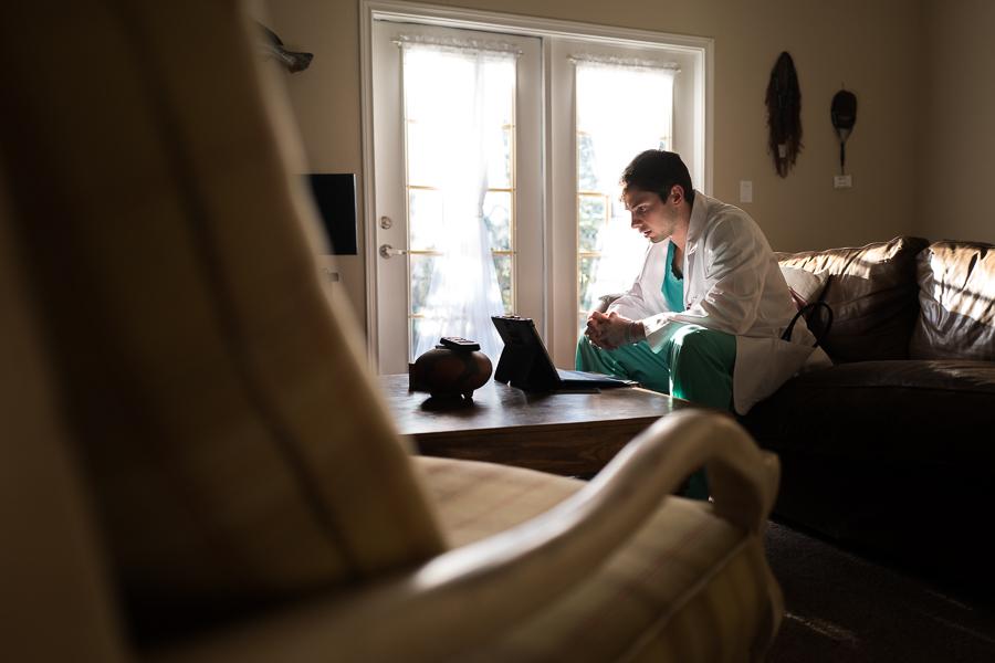 Cliff Molak looks up neighboring states legislation on his laptop. Photo by Scott Ball.