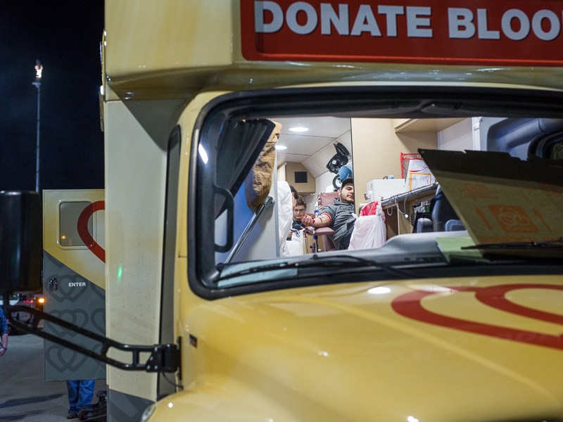 Attendees donate blood inside a mobile unit from South Texas Blood and Tissue. Photo by Scott Ball.