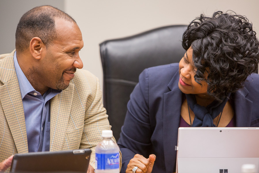 CPS Energy Interim CEO Paul Gold-Williams smiles at CPS Energy Trustee Derek Howard (left), who was approved by the board to serve as vice chair on Monday. Photo by Scott Ball.