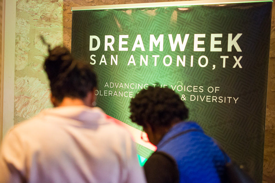 Guests stand in front of a DreamWeek poster at the Coates Chapel. Photo by Scott Ball.