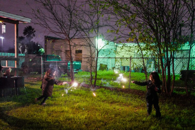 Children play with sparklers near downtown San Antonio. Photo by Scott Ball.