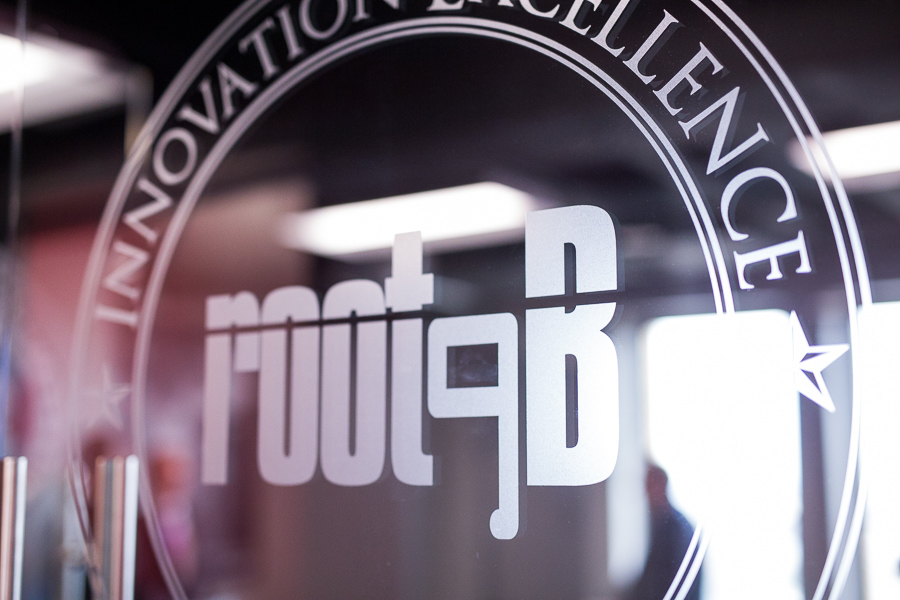 The Root9B logo is etched in a conference room window. Photo by Scott Ball.