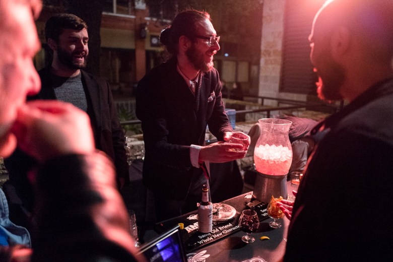 (left to right) Michael Humphries, Matty Gee, and Alex Jones discuss the consumption of cocktails. Photo by Scott Ball.