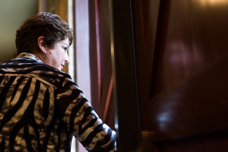 SAISD Board Trustee Olga Hernandez opens the door as she leaves the venue. Photo by Scott Ball.