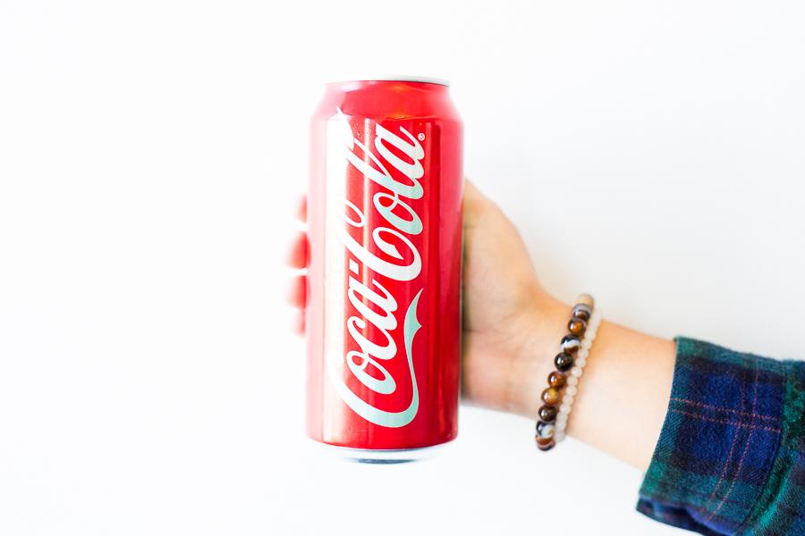 A 16 ounce can of Coca-Cola contains 52 grams of sugar.