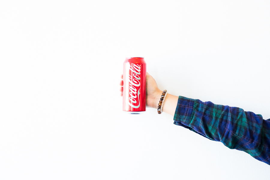 A 16 ounce can of Coca-Cola contains 52 grams of sugar.