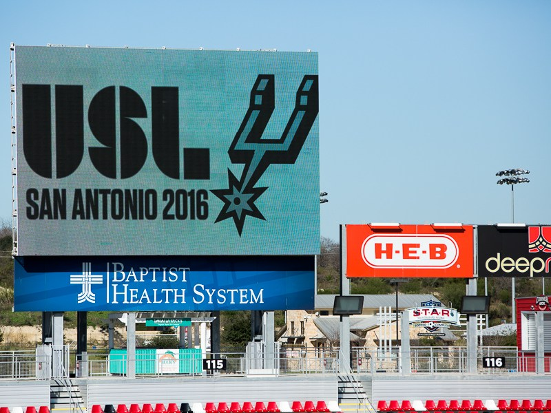 A digital banner displays the USL logo along with the San Antonio Spurs logo. Photo by Scott Ball.