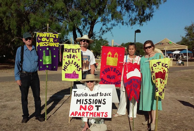 Terry A. Ybanez (second from right) stands with friends and neighbors during a recent show of protest to development near San Antonio's Spanish colonial Missions. Courtesy photo.