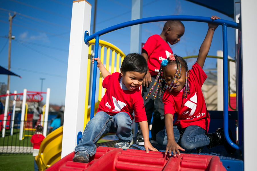 Isaiah, age 4, and Tyra, age 5 play on the newly installed playgrounds at the Harvey E. Najim Activities Center at Haven for Hope. Photo by Kathryn Boyd-Batstone