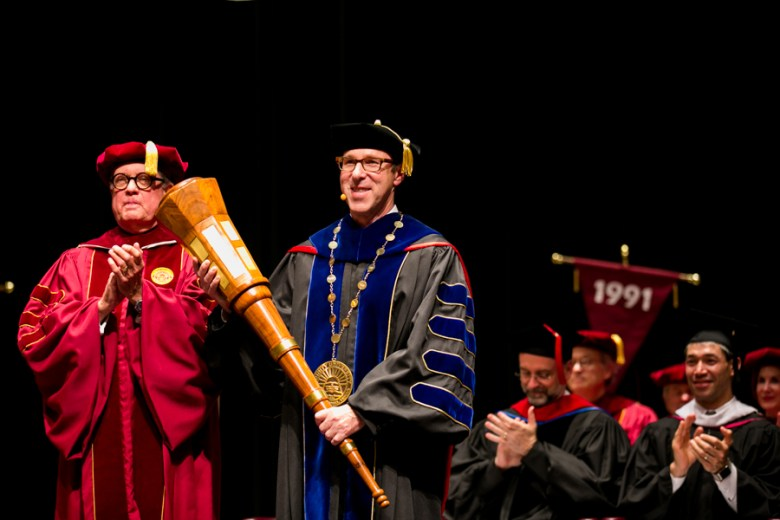 Danny Anderson hold the inaugural mace after being installed by Douglas Hawthorne, Chairman of Trinity's Board of Trustees. Photo by Kathryn Boyd-Batstone