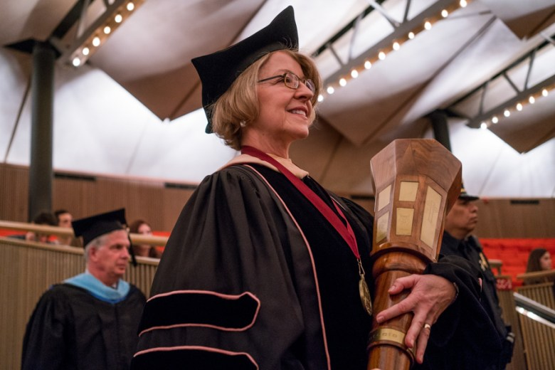Diane Persellin, Marshal of the Procession, carried in the mace for the inauguration. Photo by Kathryn Boyd-Batstone