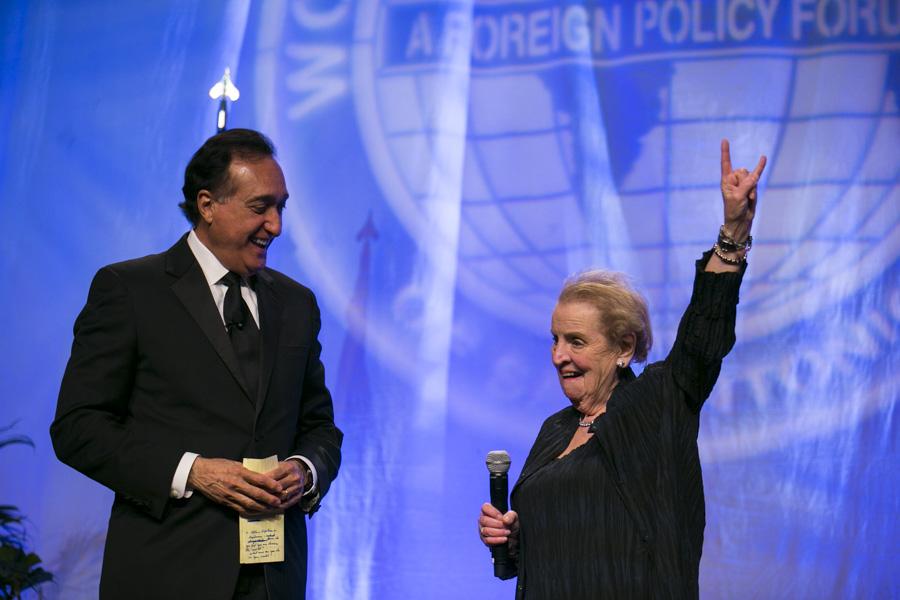 """Madam Secretary Madeleine Albright greets the crowd a """"buck 'em"""". Photo by Kathryn Boyd-Batstone"""