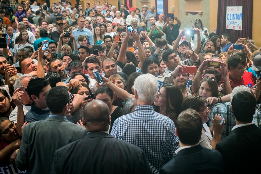 The crowd swarms former President Bill Clinton after his speech. Photo by Kathryn Boyd-Batstone