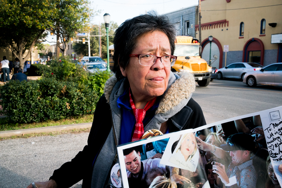 Maria Monsivaiz shows off a photo that she is in from Time Magazine taken in 1972 when Hillary Clinton visited San Antonio. Photo by Kathryn Boyd-Batstone