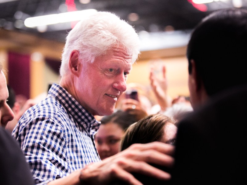 Former President Bill Clinton greets audience member after his speech. Photo by Kathryn Boyd-Batstone
