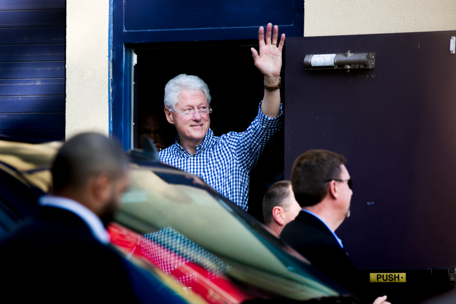 Former President Bill Clinton waves goodbye to the crowd while exiting the Guadalupe Cultural Arts Center. Photo by Kathryn Boyd-Batstone