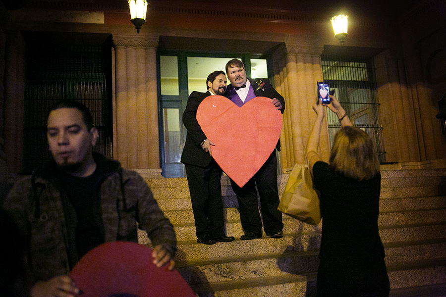 Jose Magri Flores and Patrick Miller take a photo after their Valentine's Day marriage. Photo by Kathryn Boyd-Batstone