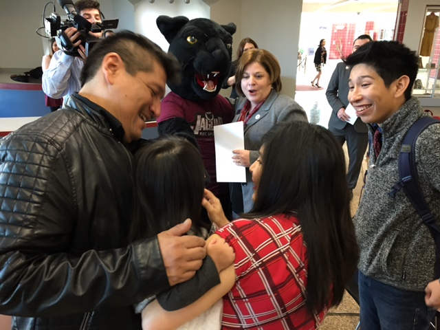 The Acosta family meets General the Jaguar, Texas A&M-San Antonio's mascot. Photo by Bekah McNeel.