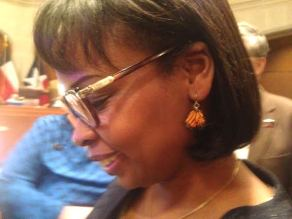 Mayor Ivy Taylor shows off her Monarch butterfly earrings in City Council chambers. Photo by Monika Maeckle.