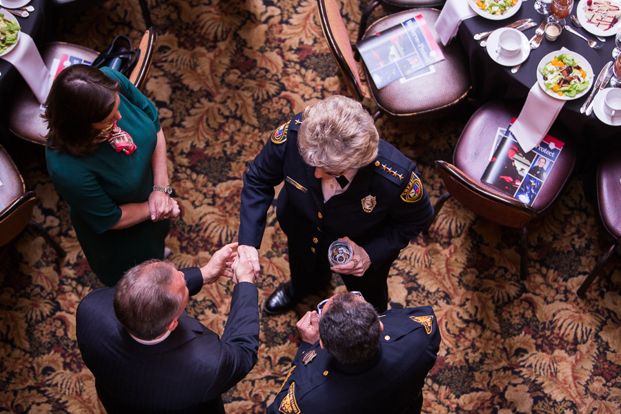 Sheriff Susan Pamerleau shakes hands with attendees at her address. Photo by Scott Ball.