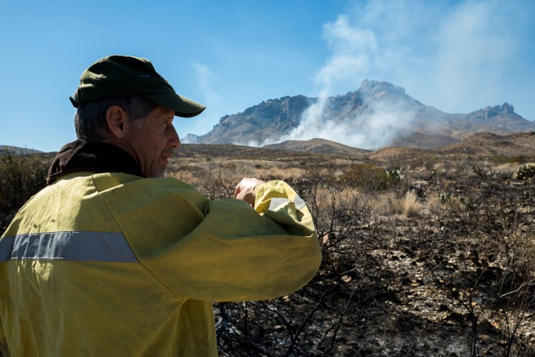 """Big Bend Public Information Officer David Elkowitz points to """"the black"""" the burnt area where the fire made its way to Gano Springs Road. Photo by Scott Ball."""