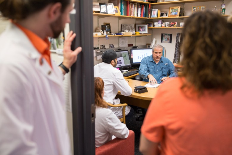 UTSA Biology Associate Professor Doctor Matthew Gdovin discusses practices with his lab students. Photo by Scott Ball.