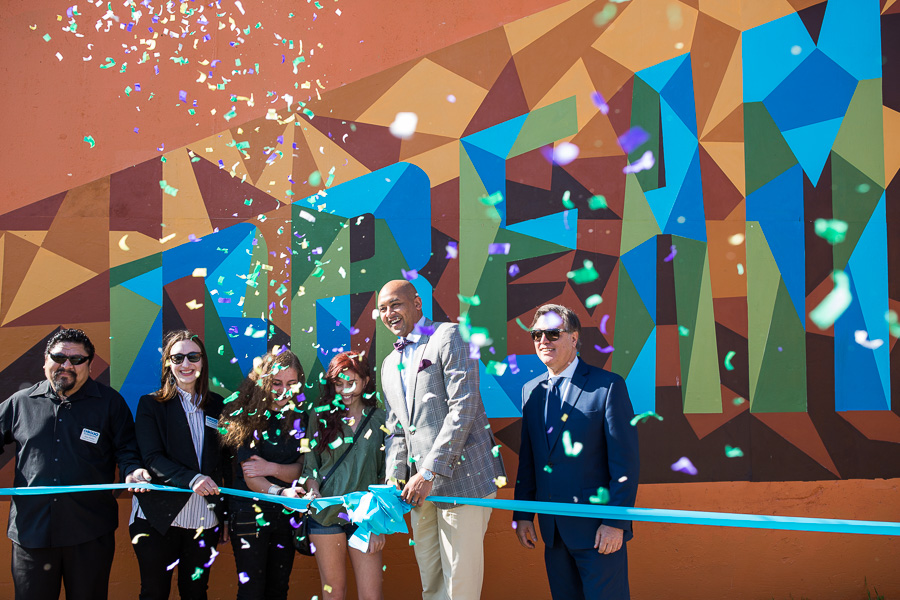 (From left) Artist Alex Rubio, Blue Star Contemporary Art Museum Executive Mary Heathcott, MOSAIC co-lead artists Elizabeth Samuel and Tanya Helbig, Councilman Alan Warrick (D2), and DCCD Director Felix Padrón pose as the ribbon is cut. Photo by Scott Ball.