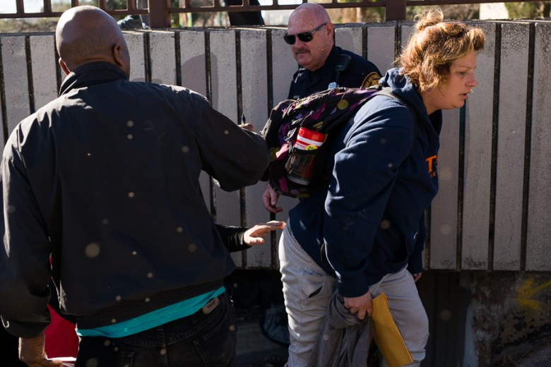 Danielle Doleshaw is removed from her living conditions before crews arrive to clean the area. Photo by Scott Ball.
